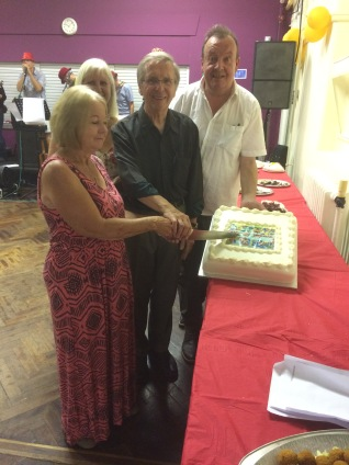 cutting the cake Len Lowles . Head of centre 1972-1987 Merial Newman ( SNIPs) Chris Brown Westfield playgroup manager 1972 -1998 Dave Roberts Head of centre since 1988.